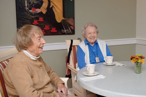 Susan Ingalls and her mother, Scott-Farrar at Peterborough assisted living resident Suzanne-Martha Chandler.