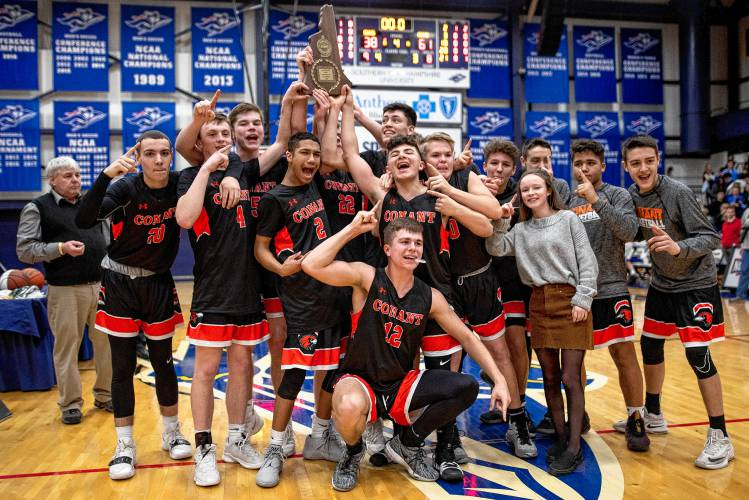 The Conant boys' basketball team won their record 12th Division III championship on Saturday. Staff photo by Ben Conant