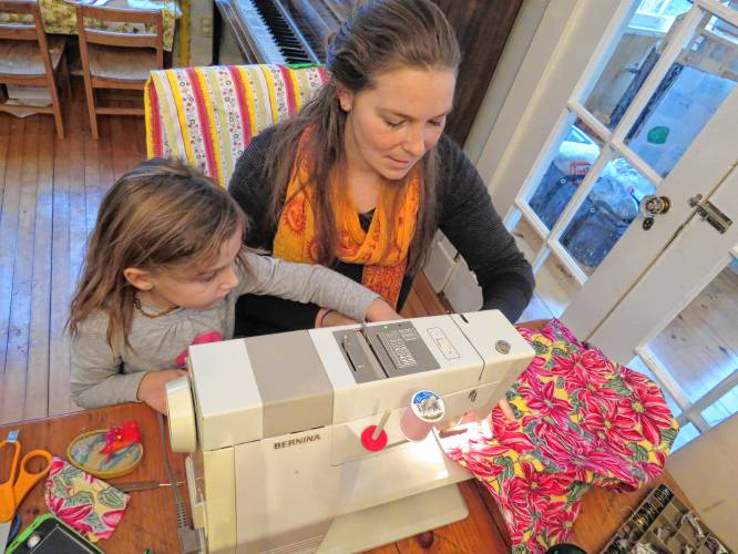 Seanna Leonard, 9, of Temple, works on sewing dresses for girls in Haiti as  part of her Brownie Troop's contribution to the Dress a Girl Around the  World ...
