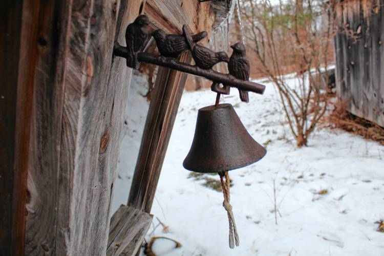 There's no doorbell for the yurt, but you can ring a more traditional bell tacked on at the door. Staff photo by Ashley Saari